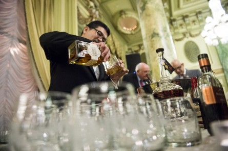 UNITED STATES - FEBRUARY 3: One of the bartenders pours some Town Branch bourbon for a guest at the Bourbon Barrel of Compromise Reception at the Willard Hotel in Washington on Tuesday, Feb. 3, 2015. The Henry Clay Center for Statesmanship and the Kentucky Distillers Association joined forces to send a barrel of Kentucky Bourbon to Washington D. C. to be received by Majority Leader Mitch McConnell. (Photo By Bill Clark/CQ Roll Call)