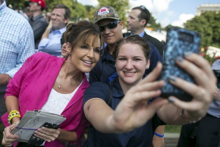 Former Alaska Gov. Sarah Palin takes a selfie with a supporter before she speaks at a rally organized by Tea Party Patriots on Capitol Hill in Washington, Wednesday, Sept. 9, 2015, to oppose the Iran nuclear agreement. (Al Drago/CQ Roll Call)