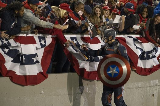 """John Walker (Wyatt Russel) greeting a crowd of adoring onlookers as the """"new"""" Captain America in Marvel Studios' THE FALCON AND THE WINTER SOLDIER"""