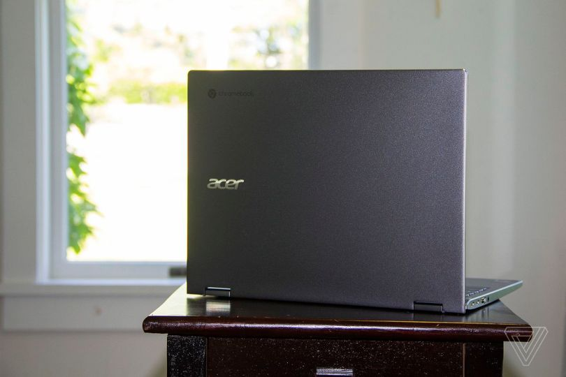 The Acer Chromebook Spin 713 open on a table seen from the back, angled to the right.