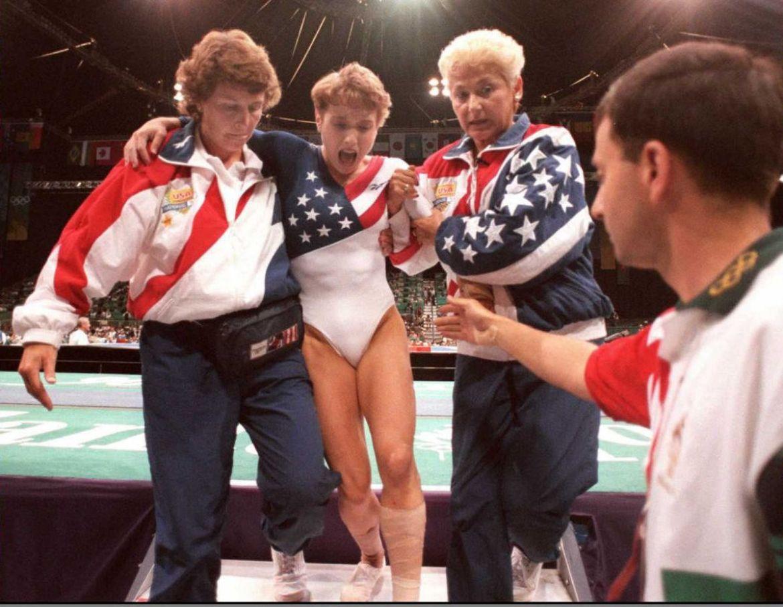 US gymnast Kerri Strug (2nd L) screams in pain as