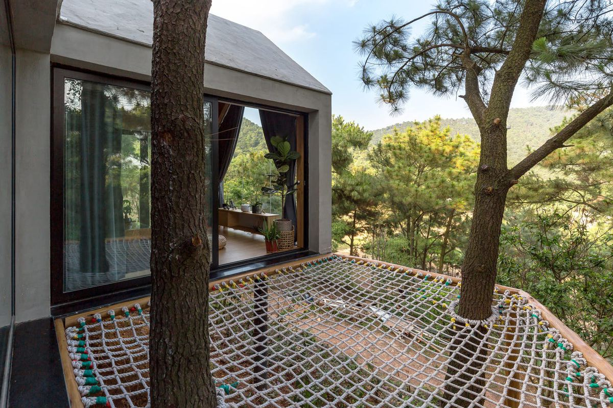Forest House In Vietnam Has A Hammock Deck