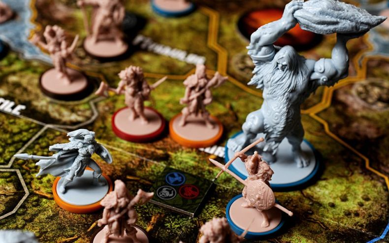 A giant hurls a boulder at a hero on the battlefield in Blood Rage.