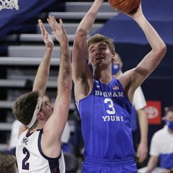 BYU forward Matt Haarms (3) shoots Gonzaga forward Drew Timme (2) during the second half of an NCAA college basketball game in Spokane, Wash. On Thursday, Jan. 7, 2021 .