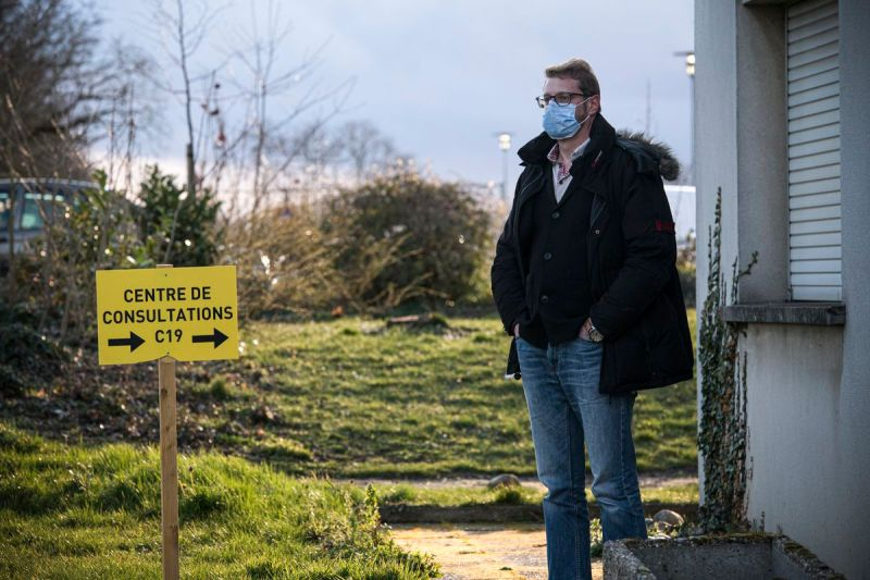 A man waits in front of the consultations center dedicated to the coronavirus in Mulhouse, France, on March 9, 2020.