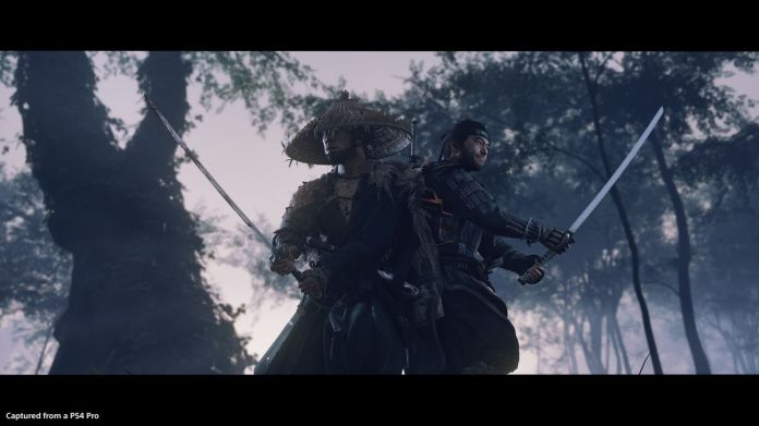 Two characters fight together with swords, back to back, in a forest in Ghost of Tsushima