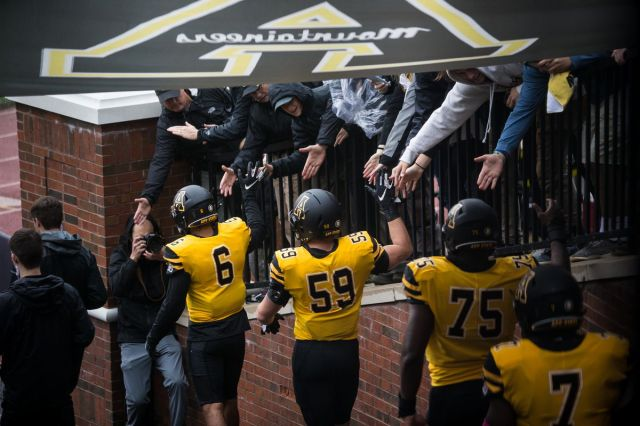 Members of the Appalachian State football team enter the field before a game between the Louisiana-Monroe Warhawks and the Appalachian State Mountaineers on October 19, 2019, at Kidd Brewer Stadium in Boone, North Carolina.