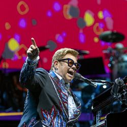 Elton John gestures out at the audience as he performs at Vivint Smart Home Arena in Salt Lake City on Wednesday, Sept. 4, 2019.