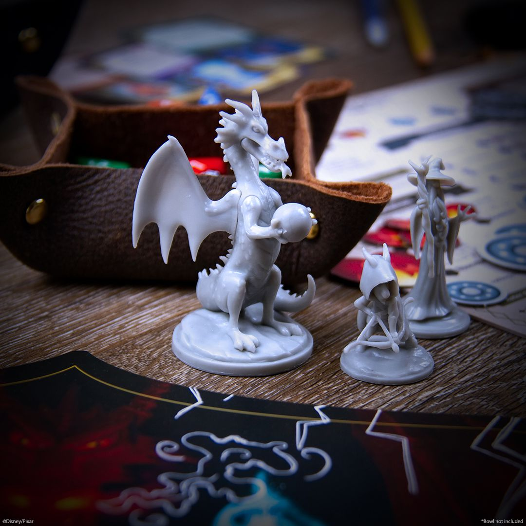 A dragon holding an orb stands next to a rogue-like character called a vagabond and a powerful wizard.