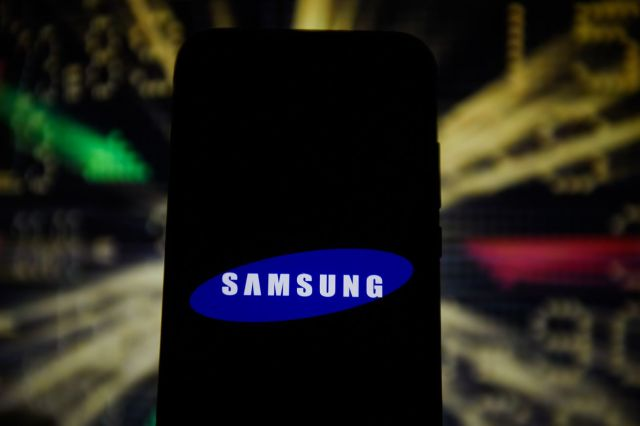 In this photo illustration a Samsung logo is seen displayed...