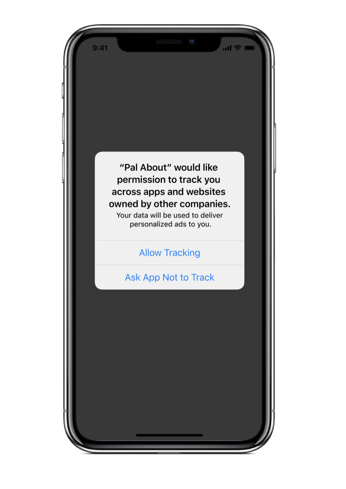 An iPhone with a pop-up message on the screen asking the user to allow tracking or not.