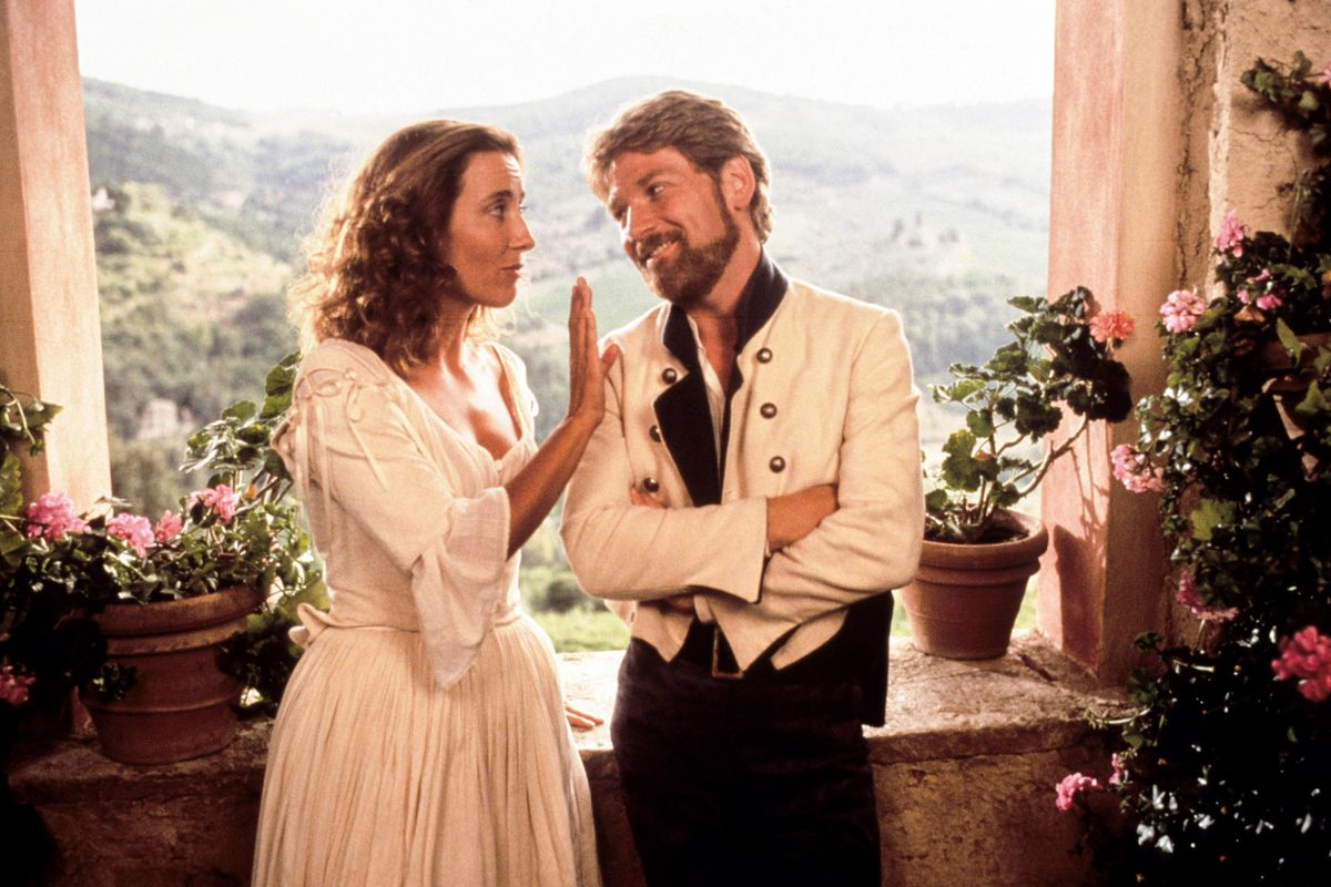 Beatrice (Thompson) and Benedick (Branagh) look at each other affectionately.