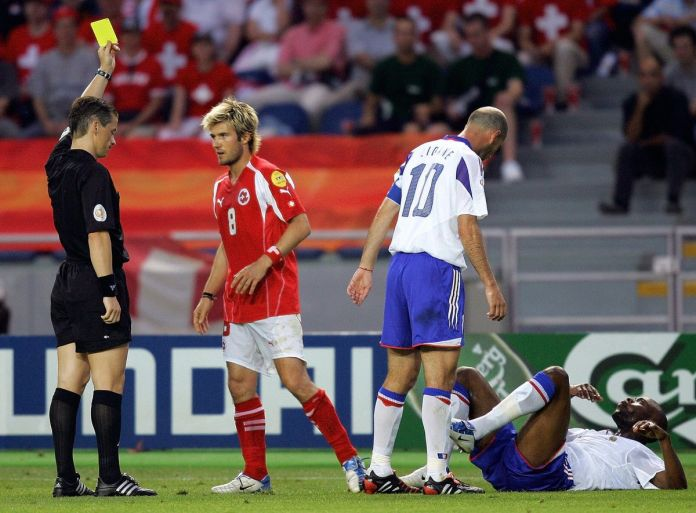 Slovak referee Lubos Michel (left) gives
