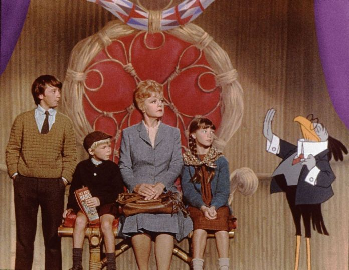 Eglantine Price (Angela Lansbury) seated in a huge chair, with her young wards and an anthropomorphic bird around her.