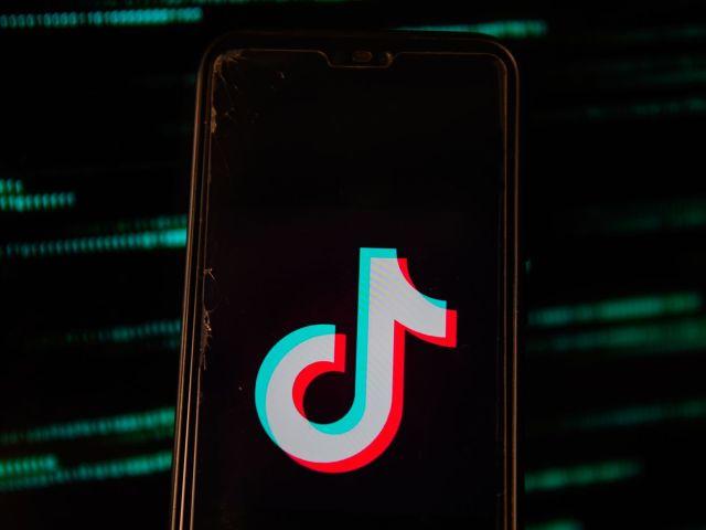 A TikTok logo seen on a phone.