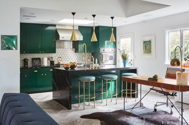 The emerald green kitchen with brass fixtures and detailing.