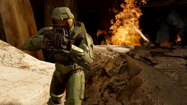 Master Chief stands near some fire in Halo 2 Anniversary