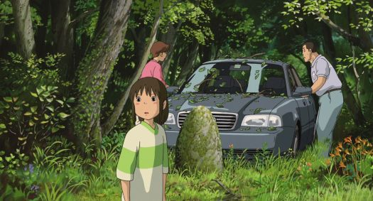 chihiro looks back at the gate that led her to the spirit world in spirited away