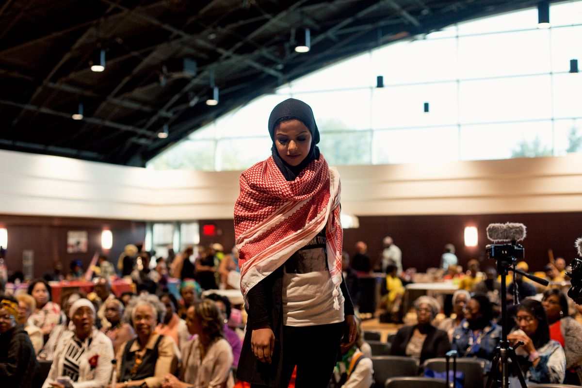 A woman in a hijab onstage at the expo.