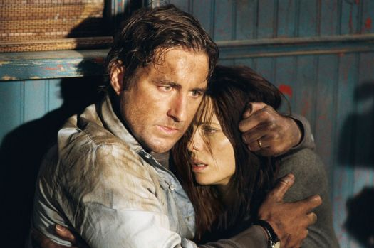 A grubby Luke Wilson puts protective arms around a grubby Kate Beckinsale as they both look shell-shocked in Vacancy