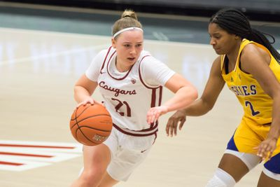 PULLMAN, WA - FEBRUARY 28: Washington State guard Johanna Teder (21) drives to the hoop during the second half of a Boeing Apple Cup Series matchup between the Washington Huskies and the Washington State Cougars on February 28, 2021, at Beasley Coliseum in Pullman, WA.