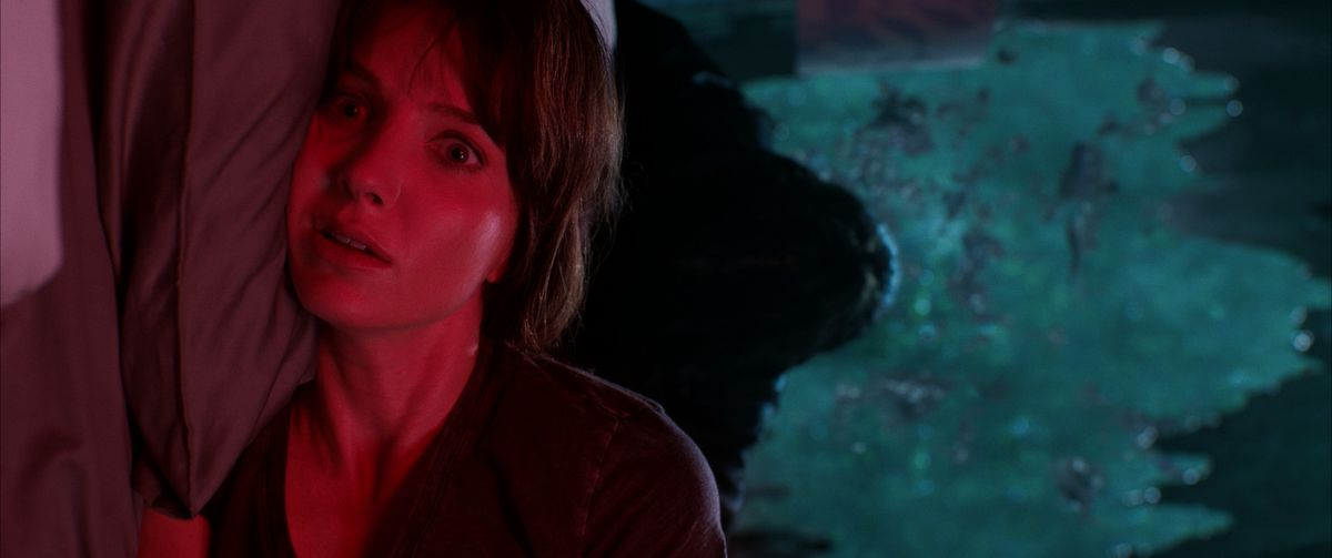 Protagonist Madison lies awake in fear as something rises behind her in the trailer for Malignant