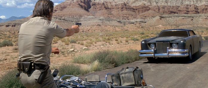 james brolin points a gun at a sentient car in The Car