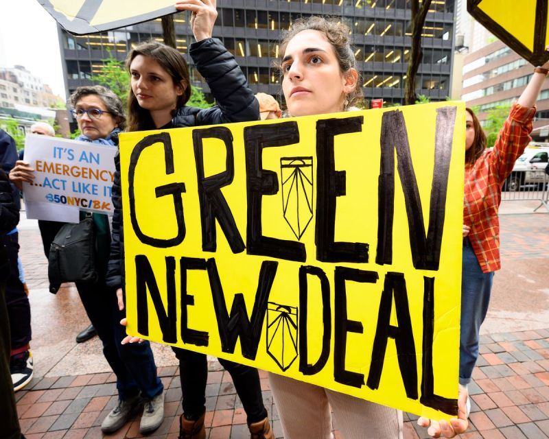 A protester holding a placard during the Sunrise NYC-organized rally in support of the Green New Deal outside Senator Chuck Schumer's (D-NY) New York City office, April 30, 2020