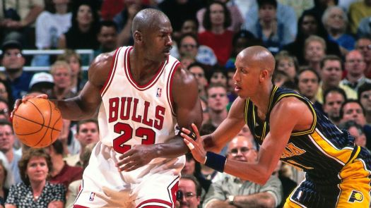 Michael Jordan plays basketball against another basketball player
