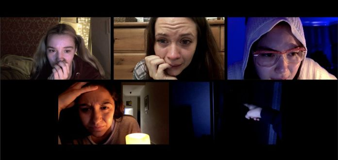 A group of frightened people stare at their webcams in a group video chat in Host.