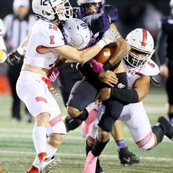 Riverton's Brayden Hunkin is taken down by East's Spencer Black and Say Tafisi as East and Riverton play a high school football game in Riverton on Friday, Oct. 9, 2020. East won 36-20.