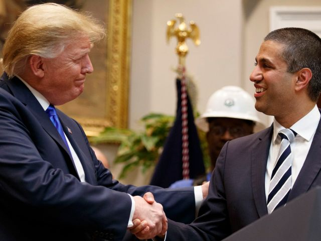 President Donald ***** and FCC Chair Ajot Pai shake hands.