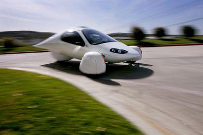 The Aptera 2e electric three-wheeled car is driven near the
