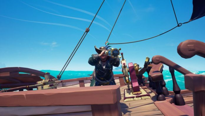 Sea of Thieves - a player holds a looking glass up to their eye to survey the horizon.