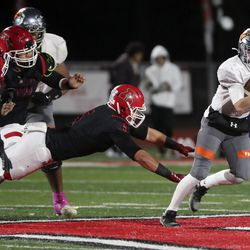 Skyridge's McCae Hillstead runs with the ball past American Fork's Spencer Clegg during a varsity football game at American Fork High School in American Fork on Wednesday, Oct. 13, 2021. Skyridge won 42-22.