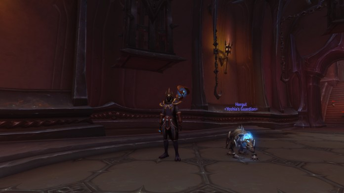 World of Warcraft - a player stands next to an undead bone beast in the halls of Torghast.