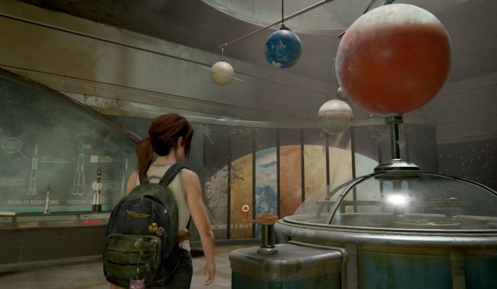 Ellie from The Last Of Us Part 2 in a tank top in a museum looking at planets