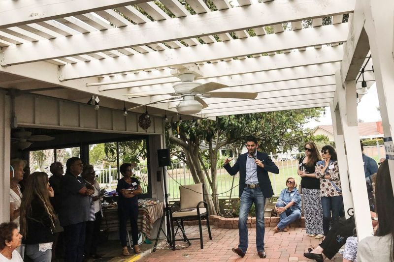 Democrat Ammar Campa-Najjar answers voters' questions on policy at a campaign stop in San Marcos, California.