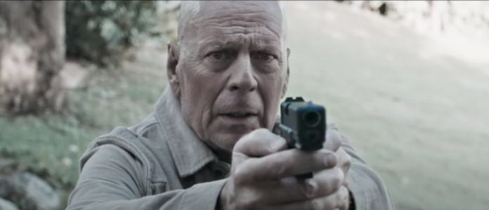 Bruce Willis holding a gun in Out of Death