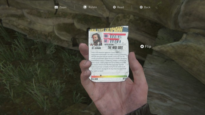 Ellie looking at the back of the Doctor Uckmann trading card in The Last of Us 2