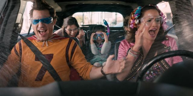 a family in a car with some kooky costumes