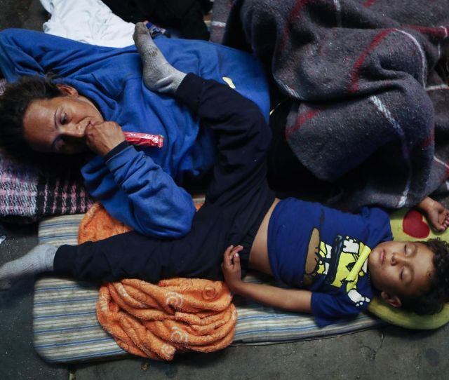 Honduran Migrant Daniel Bonilla Ii R Sleeps Next To His Mother Rosa On The Street Outside A Temporary Shelter Set Up For Members Of The Migrant Caravan