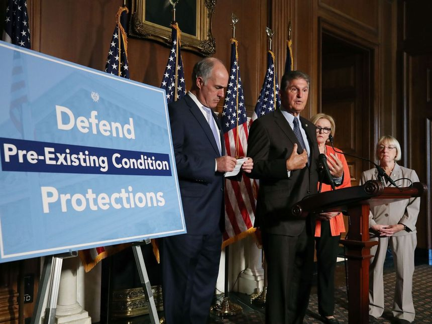 Sen. Joe Manchin (D-WV) speaks on a proposed protection plan for people with preexisting health conditions, during a news conference on Capitol Hill July 19, 2018, in Washington, DC.