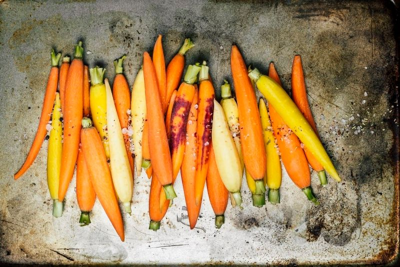 A variety of carrots on a baking sheet