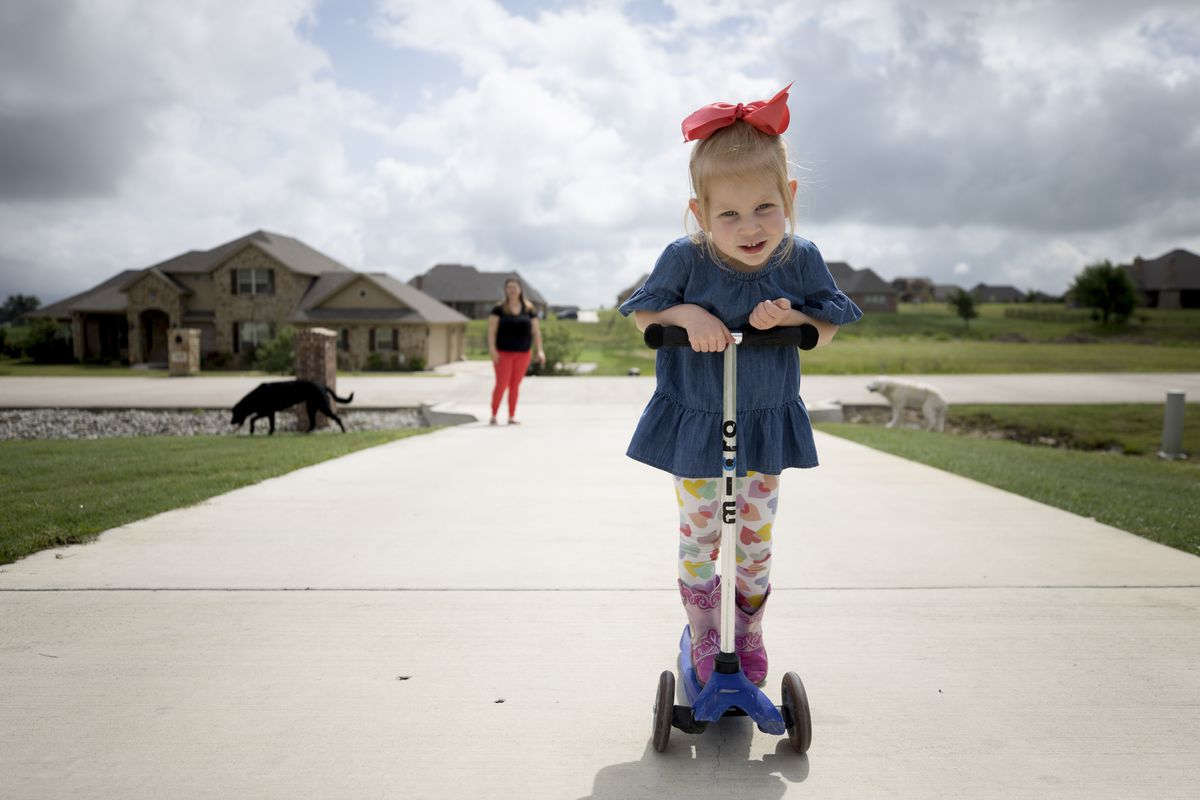 Lily Clark, 3, plays outside her home in Aledo, Texas.