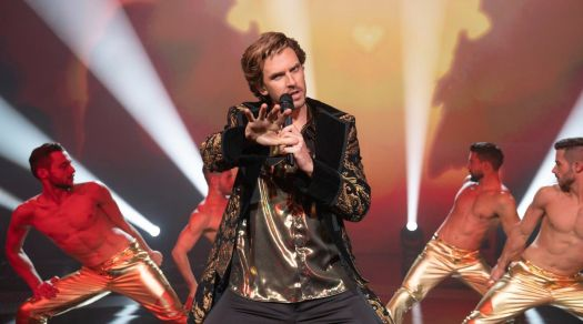 Dan Stevens performs onstage in Eurovision Song Contest