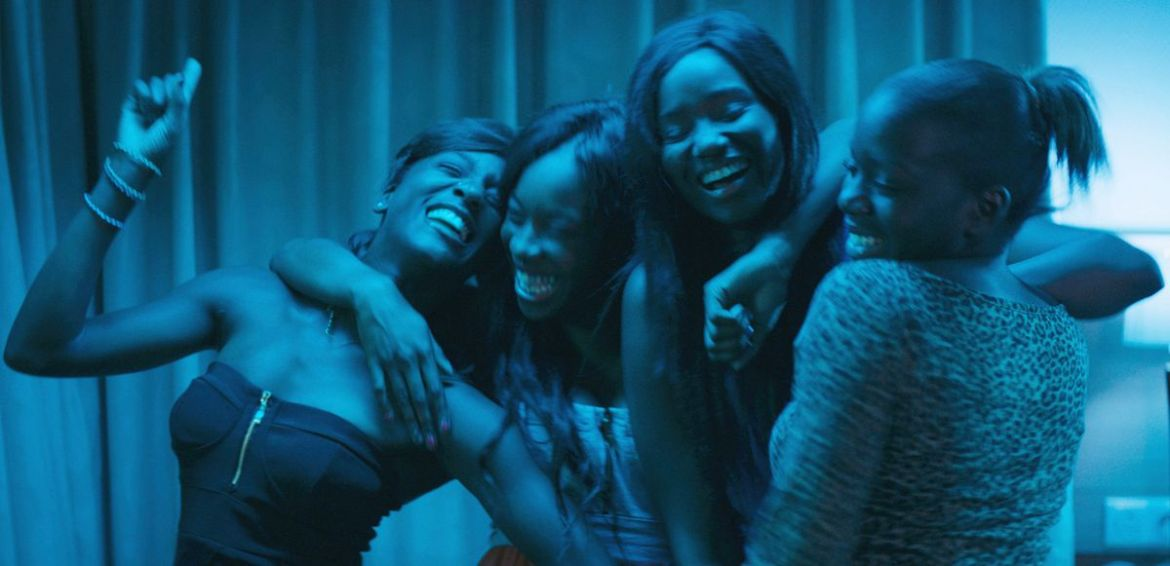 The cast of Girlhood laughing and singing karaoke together