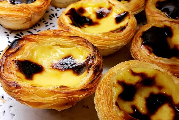 Egg tarts on a plate.