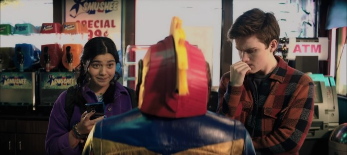 Kamala Khan and a friend look at a Captain Marvel outfit in a sizzle reel for Marvel's Ms. Marvel.
