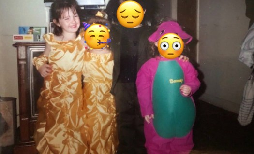 a group of kids dressed like Belle, darth vadar, and barney